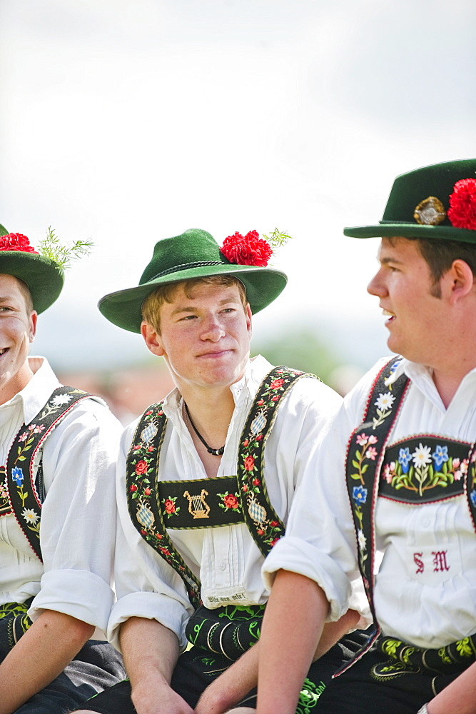 Three young men wearing traditional costumes, May Running, Antdorf, Upper Bavaria, Germany