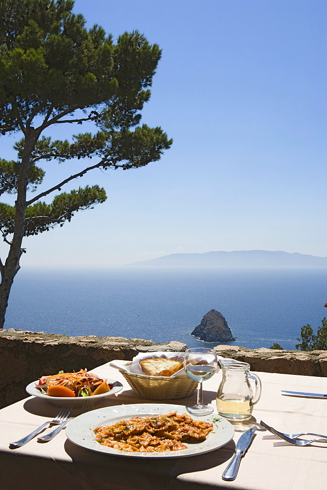 Monte Argentario, terrace of the restaurant Il Bottegone with its view of Giglio island, Monte Argentario, Maremma, Tuscany, Italy