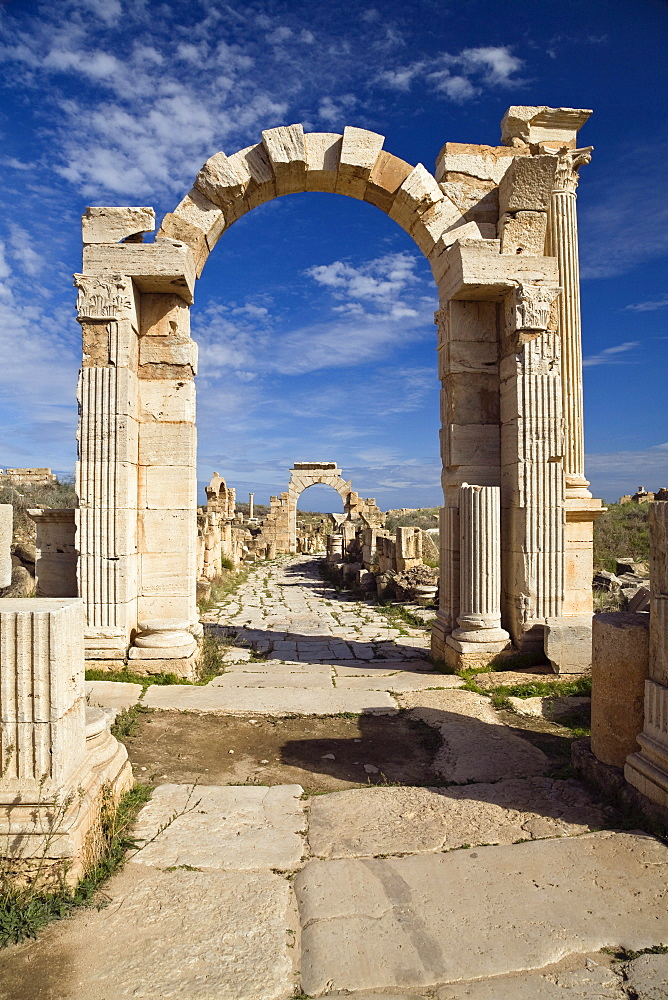 The Arch of Trajan on Via Trionfale, Arch of Tiberius in the background, Leptis Magna, Libya, Africa