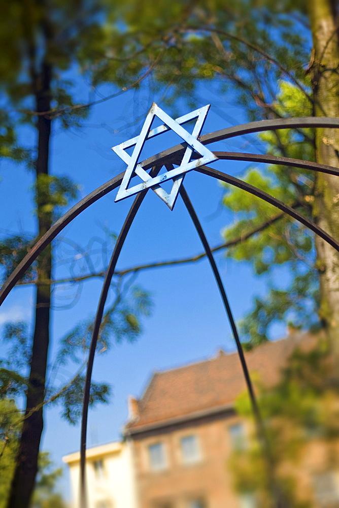 Jewish Star in courtyard on Szeroka in Jewish Kazimierz Quarter, Krakow, Poland, Europe