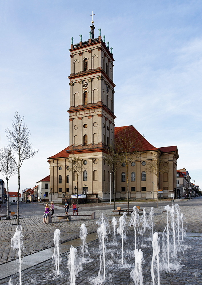 Market square with water displays and the city church, Neustrelitz, Mecklenburg Lake district, Mecklenburg-Western Pomerania, Germany