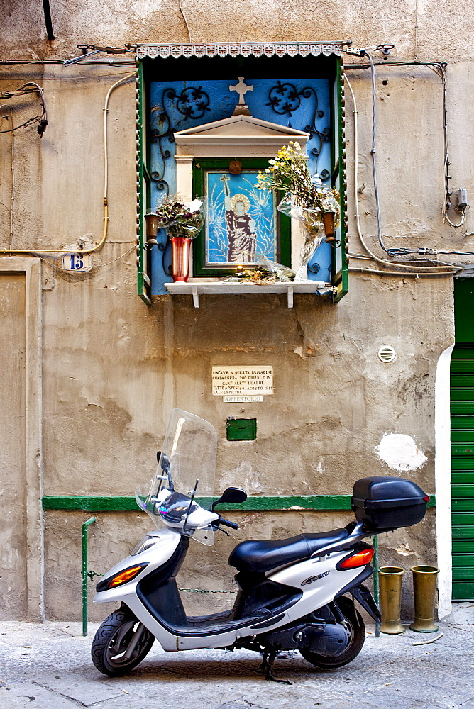 Scooter and the saint image, Palermo, Sicily, Italy
