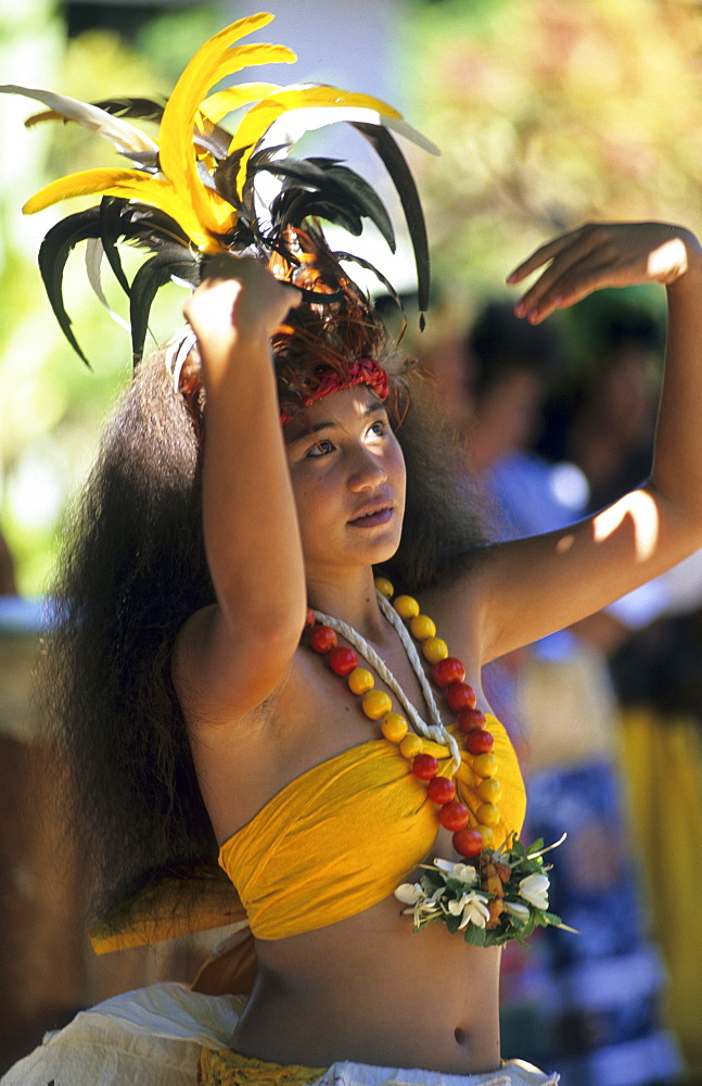 Young woman dancing a dance of welcome in the town of Hakahau on the Island of Ua Pou, French Polynesia