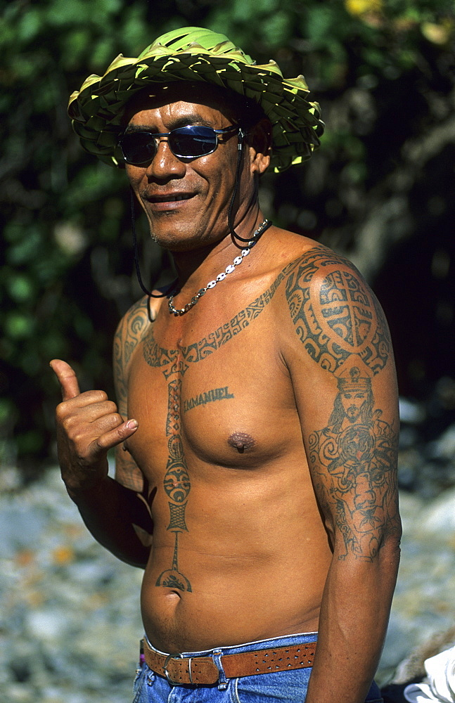 A Polynesian with traditional tattoos in the village of Hakahetau on the island of Ua Pou, French Polynesia