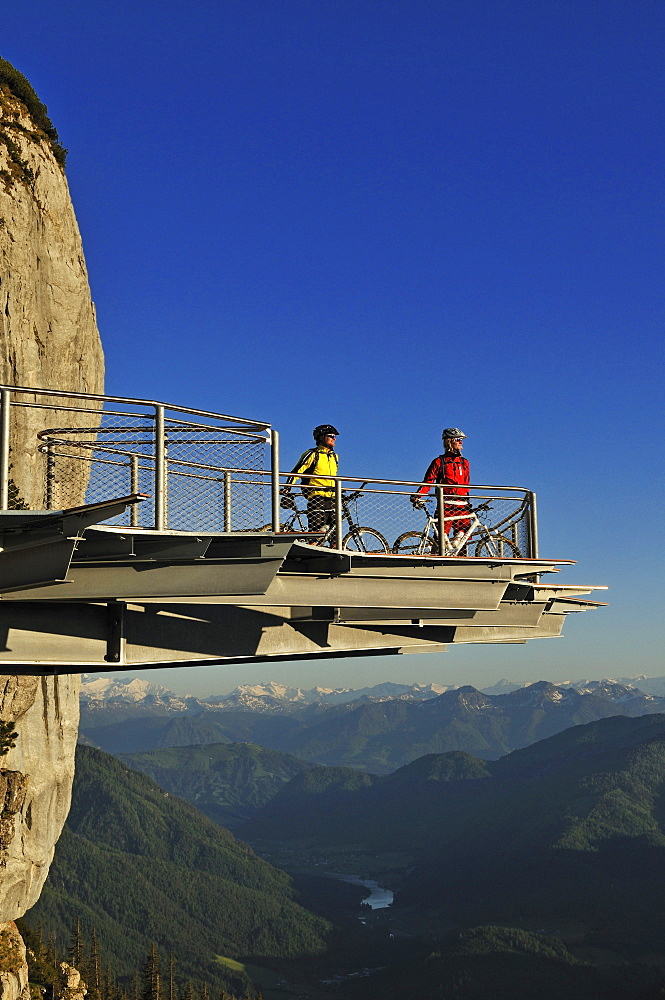 People on mountain bikes on viewing platform at Triassic Park, Reit im Winkl, Bavaria, Germany, Europe