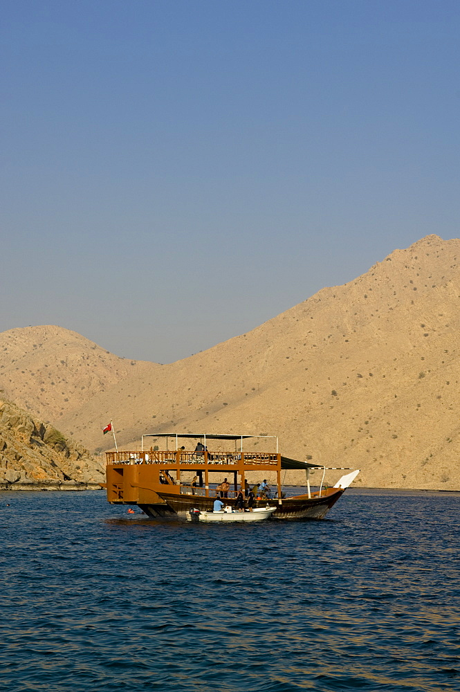 Boat with tourists, Dhow, in the Haijar Mountains, Musandam, Oman