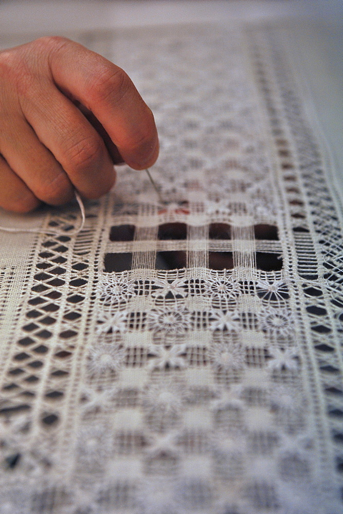 working on a piece of embroidery in the Casa de las Balcones, La Orotava, Tenerife, Canary Islands, Spain