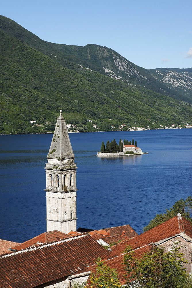 View of Sveti Nikola church with bell tower, in the background Gospa od Skrpjela island, Perast, Bay of Kotor, Montenegro, Europe