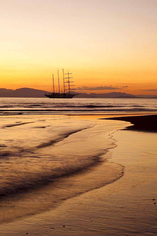 Beach and sailing cruiseship Star Flyer (Star Clippers Cruises) at sunset, Puerto Caldera, Puntarenas, Costa Rica, Central America, America