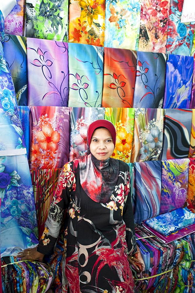 Woman selling colourful fabric, Little India, Kuala Lumpur, Malysia, Asia