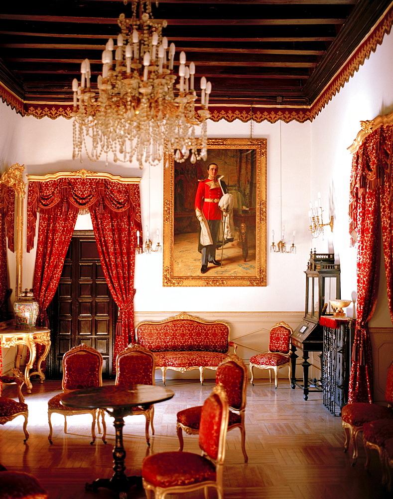 Red private salon functions as museum, Hotel Palacio de la Rambla, ⁄beda, Andalusia, Spain