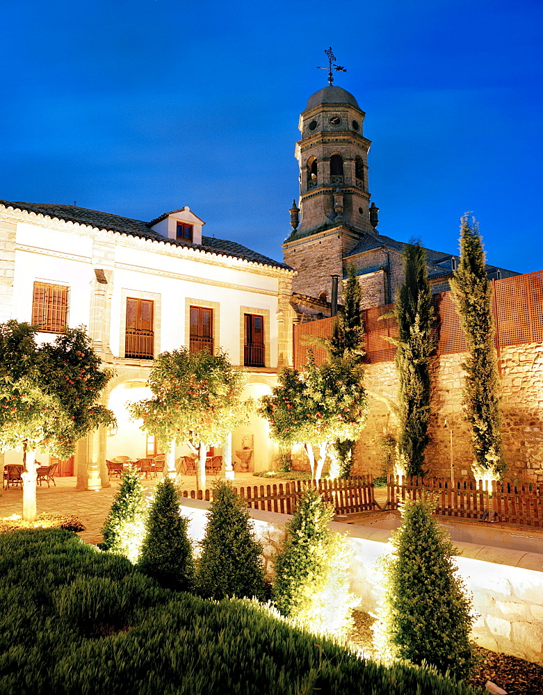Courtyard of hotel Puerta de la Luna with orange trees, at night, historic centre beneath the cathedral, Baeza, Andalusia, Spain