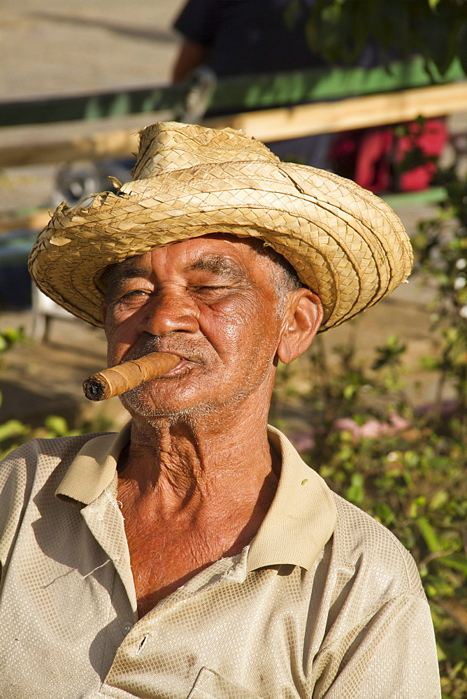 Old Man with cigar in front of village church, Vinales Valley, Province Pinar del Rio, Cuba, Greater Antilles, Antilles, Carribean, West Indies, Central America, North America, America