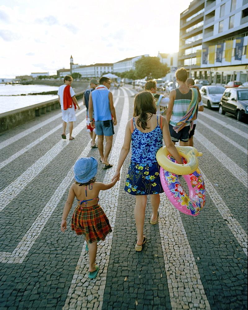 Bathers walking the promenade, Ave. Infante Dom Henrique, Ponta Delgada, Sao Miguel island, Azores, Portugal