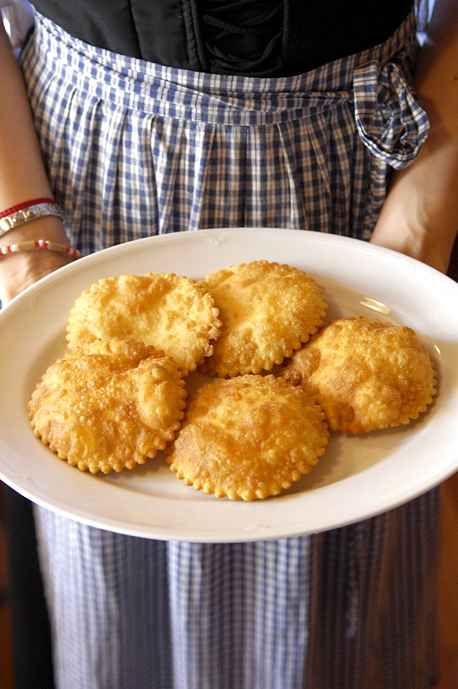 Pasties on a plate in a restaurant, Brunico, Val Pusteria, Alto Adige, South Tyrol, Italy, Europe