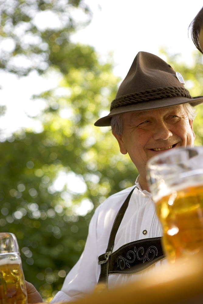 Senior man in beergarden near Lake Starnberg, Bavaria, Germany