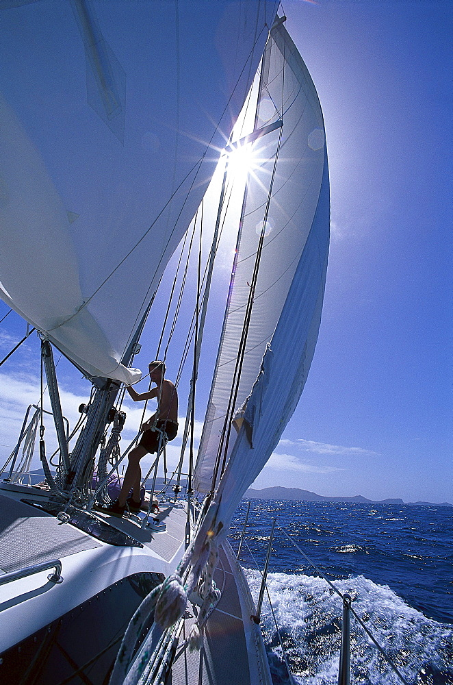 Man on a sailing boat in the sunlight, St. Vincent and The Grenadines, Caribbean, America