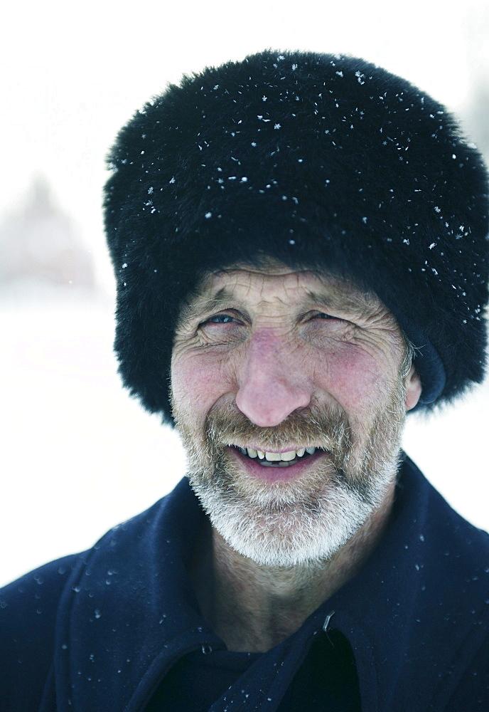 Mature man wearing a fur hat, Omsk, Siberia