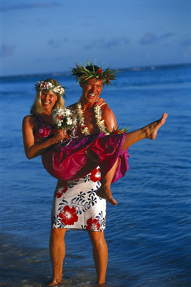Groom carries bride, South Seas Wedding, Rarotongan Beach Resort, Rarotonga, Cook Islands, South Pacific