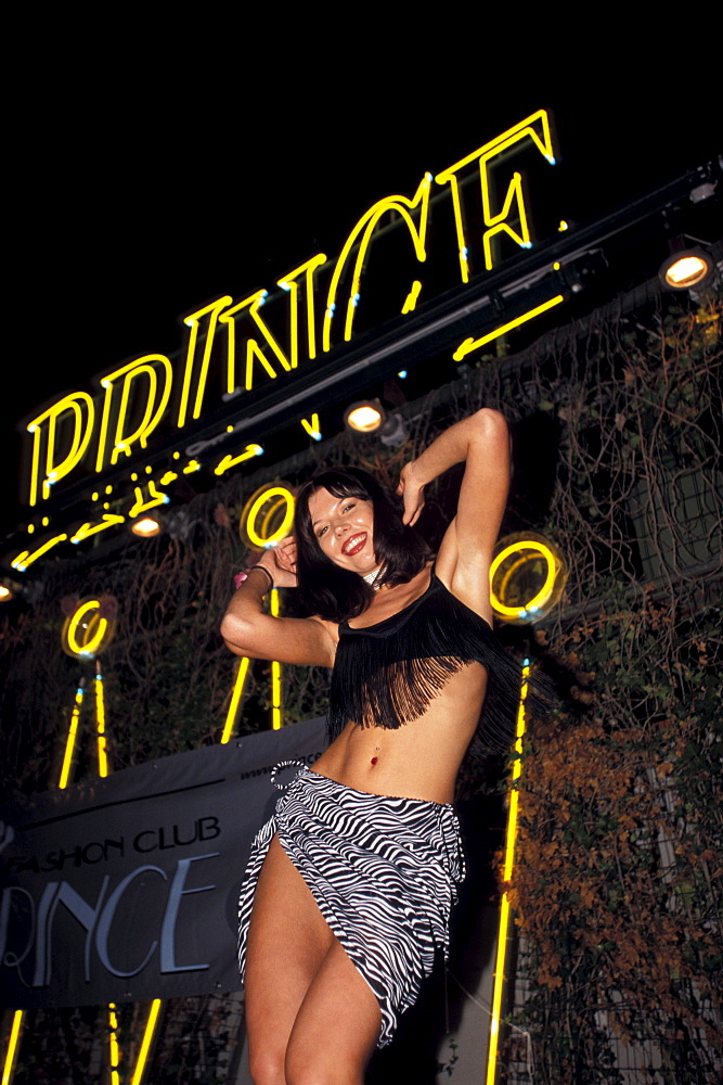 Dancer in front of the neon signs of the Prince Nightclub, Riccione, Province of Rimini, Italy, Europe