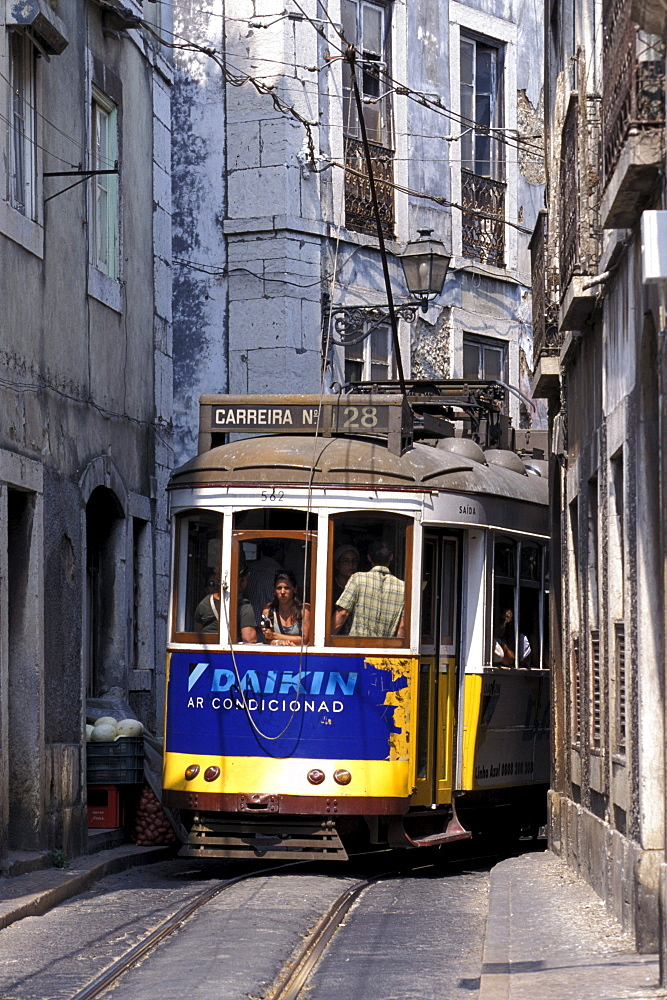 Tram in a narrow alley, Electrico 28, Alfama, Lisbon, Portugal, Europe