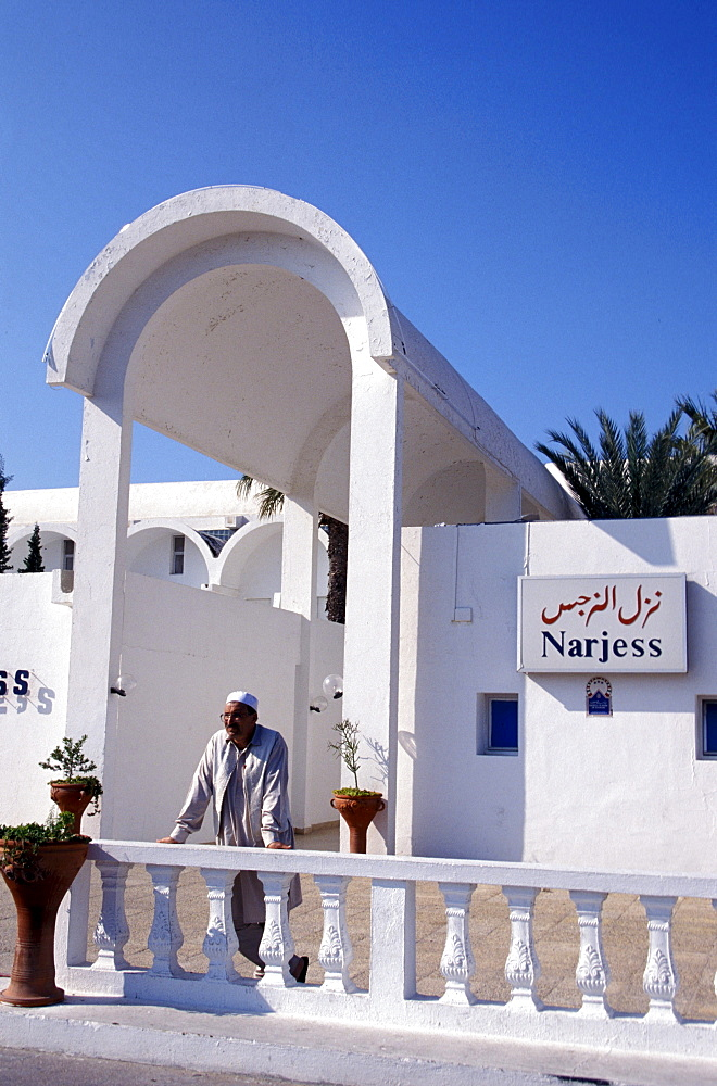 Person in front of the Dar Djerba hotel, Djerba, Tunesia, Africa