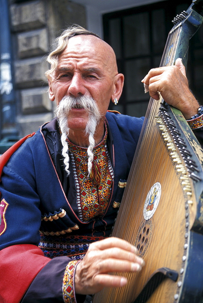 Street Musican in Traditional Costume, Cracow, Poland