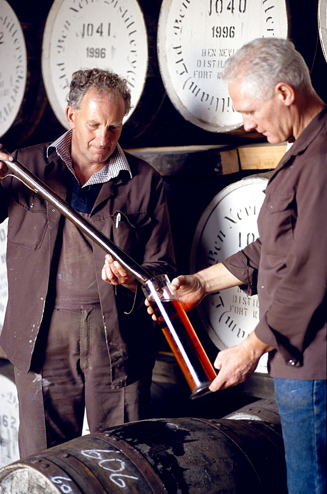 Two men testing whiskey at Ben Nevis distillery, Fort William, Invernesshire, Scotland, Great Britain, Europe