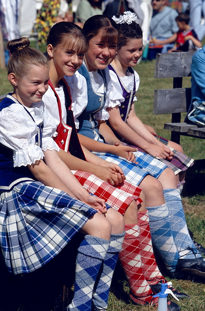 Highland Fling Dancers, gilrs on a bench, Glenfinnan Highland Games, Invernesshire, Scotland, Great Britain, Europe