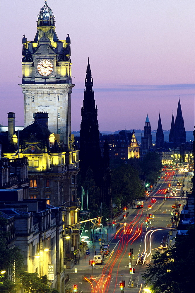 Illuminated clock tower and Princess Street at night, Edinburgh, Scotland, Great Britain, Europe
