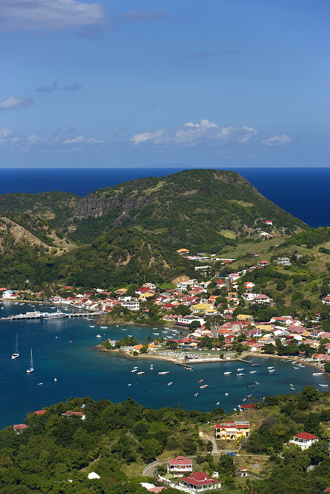 Aerial View towards Terre-de-Haute, boats in the harbour surrounded by mountains, Les Saintes Islands, Guadeloupe, Caribbean Sea, Caribbean, America