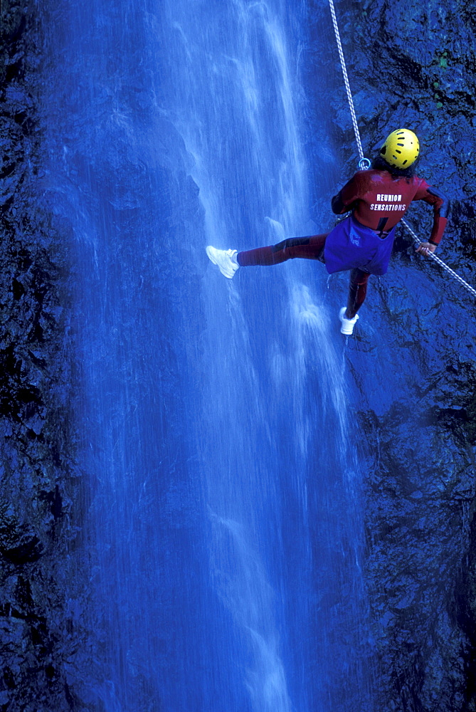 Person canyoning at Gobert Waterfall, Cilaos, La RÈunion, Indian Ocean