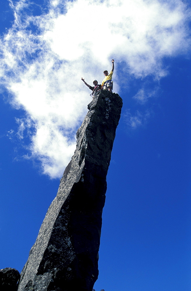 Two climbers standing on the top of a mountain peak, Trois Salazie, Gros Morne, Ille de la RÈunion, Indian Ocean