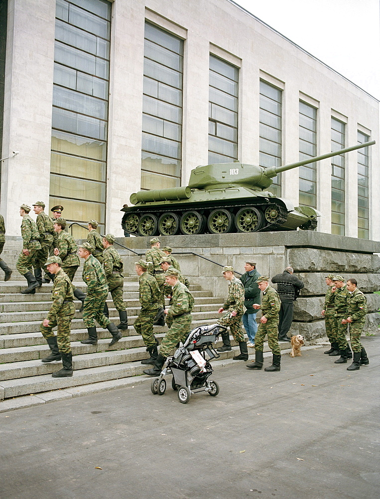 Soldiers climbing stairs in front of the Central Armed Forces Museum, Moscow, Russia
