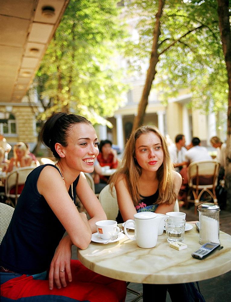 Two young women on cafe's terrace, Cafe Coffeemania, Bolschaja Nikitskaja Street, Mowcow, Russia