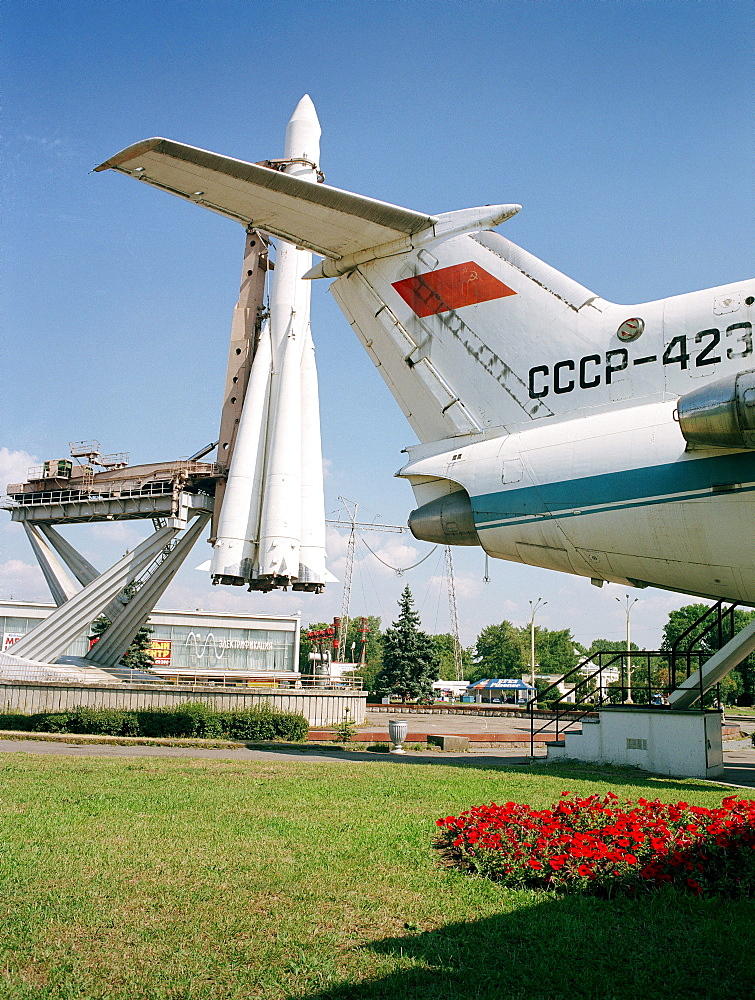Soyuz rocket and tail of Yak-42 airplane in All-Russia Exhibition Centre, Moscow, Russia, before 2003