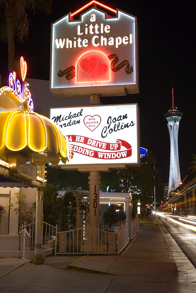 A little white chapel on Las Vegas Boulevard, The Strip. Stratosphere Tower in the background. Downtown Las Vegas, Nevada, USA