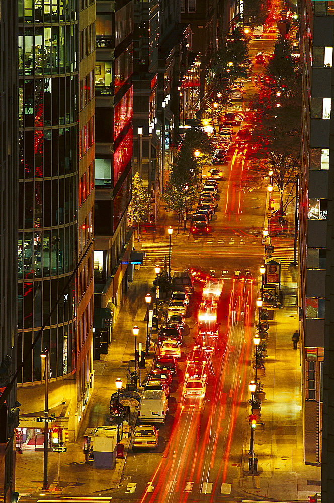 Cars on a street downtown in the evening, Business District, 17th Street, Philadelphia, Pennsylvania, USA, America