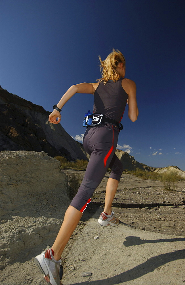 Woman running, jogging in Andalusien, Spain