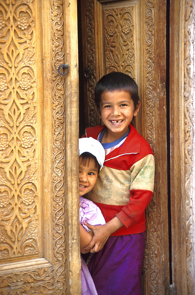 Smiling children at door, Chiwa, Uzbekistan