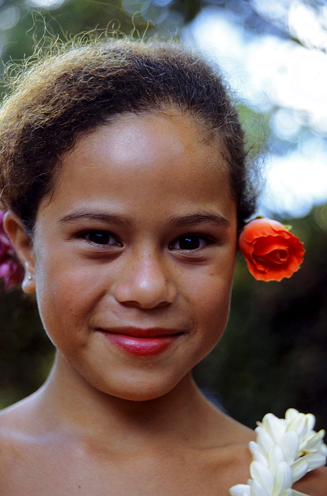 Portrait of a young girl with a flower in her hair, dancer, Ua Huka, Marquesas French Polynesia, South Pacific