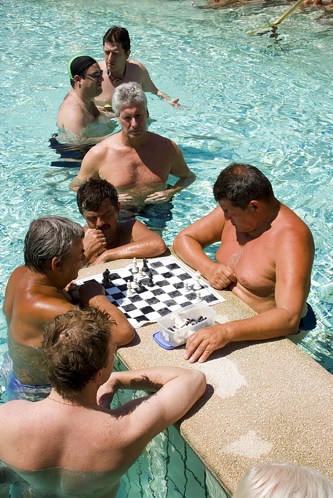 Men playing chess in a thermal bath, Men playing chess in a thermal bath of the Szechenyi-baths, Pest, Budapest, Hungary