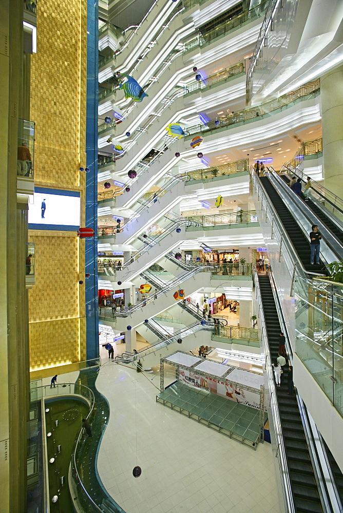 Shopping Shanghai, New World, Yao Han, shopping mall, escalator, shops, stores, mega malls, multi storey, advertising, consumers, fashion, design, atrium