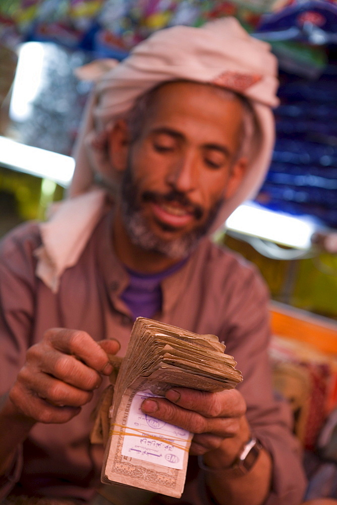 Man counting money, Sana'a, Yemen