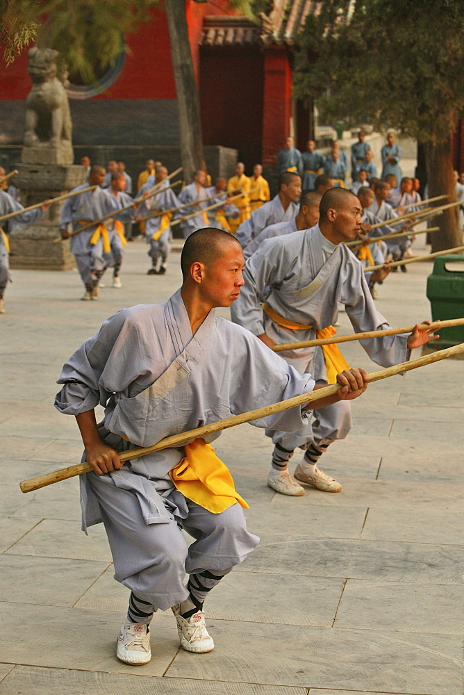 Shaolin Buddhist monks rehearsing for a performance on Buddhas birthday, Shaolin Monastery, known for Shaolin boxing, Taoist Buddhist mountain, Song Shan, Henan province, China