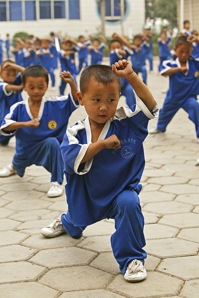 Kung Fu training at kindergarten age, at one of the many new Kung Fu schools in Dengfeng, school near Shaolin, Song Shan, Henan province, China, Asia