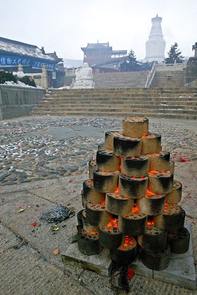 Fire with coal for the Chinese New Year festival, Great White Pagoda, village of Taihuai, Mount Wutai, Wutai Shan, Five Terrace Mountain, Buddhist centre, town of Taihuai, Shanxi province, China