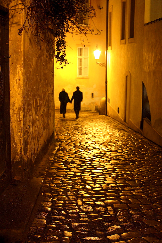 Couple walking down an alley, Mala Strana, Little Quarter, Prague, Czech Republic