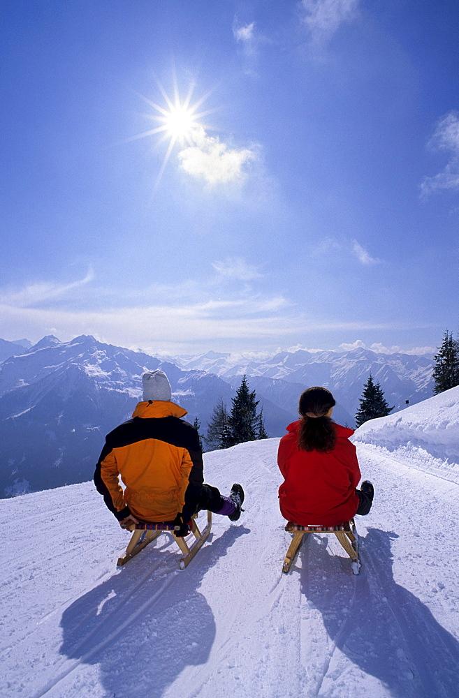 Two persons sledging on toboggan-run Bramberg, Wildkogel, Neukirchen, Salzburg, Austria