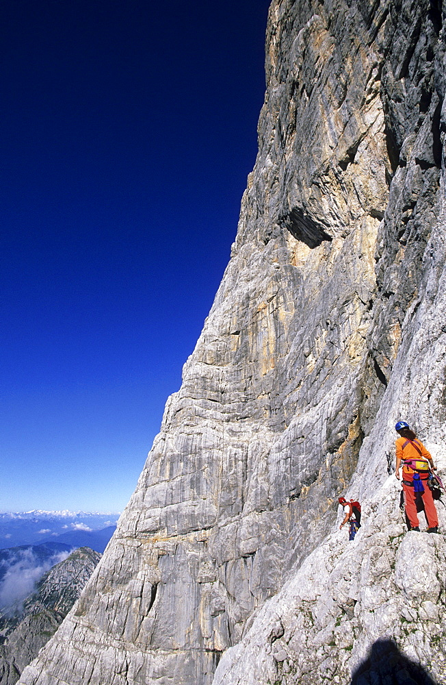 climber on south face of Dachstein, Steiner route, Dachstein range, Styria, Austria